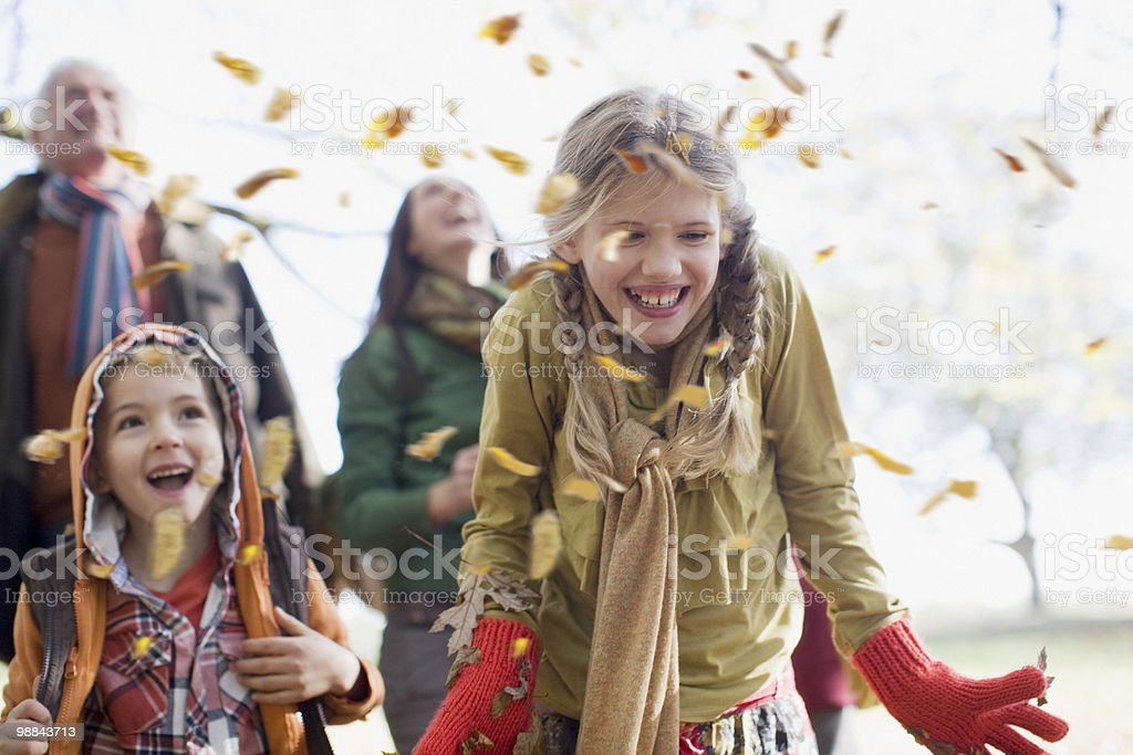 Family laughing outdoors stock photo