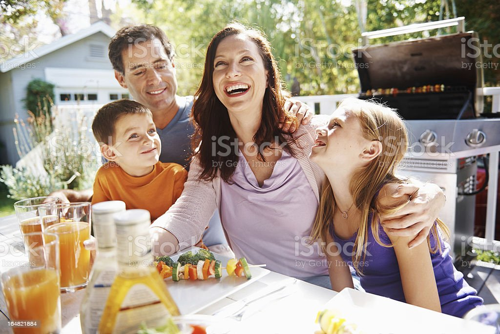 Family laughter in the sun stock photo