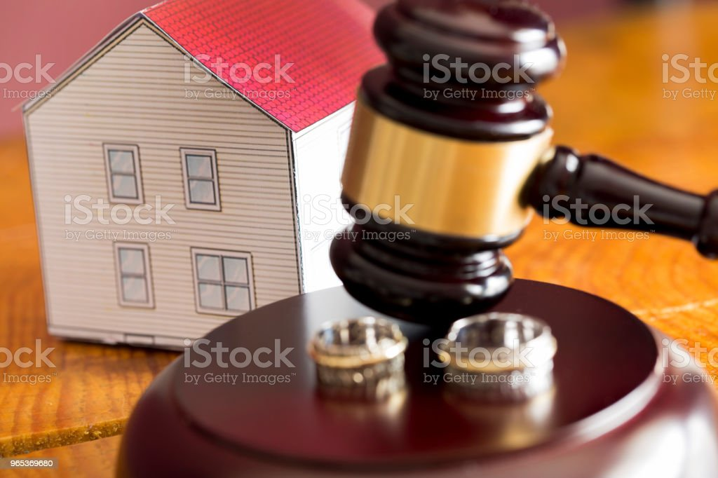 Family law concept. Divorce. Gavel, house and rings zbiór zdjęć royalty-free