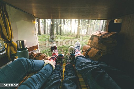 Family with little boy laying in camper van in Christmas socks