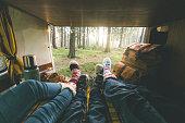 Family laying in camper van in Christmas socks
