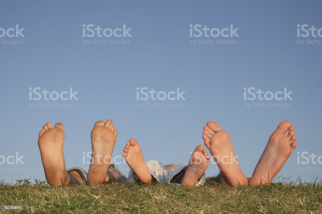 family legs on grass royalty-free stock photo