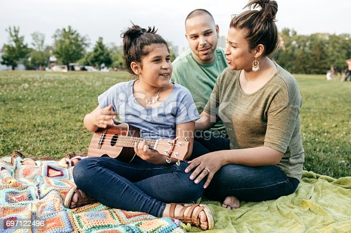 istock Family listening daughter's song 697122496