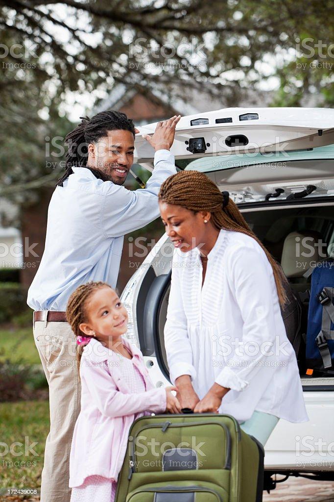 Family loading luggage into car royalty-free stock photo
