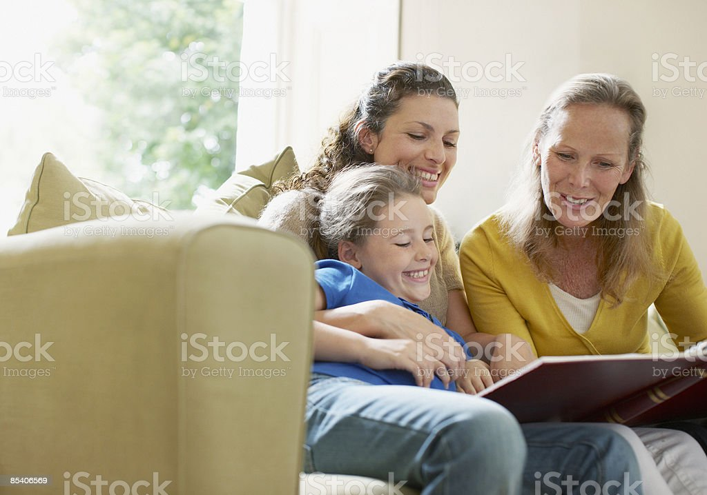 Family looking a photograph album royalty-free stock photo