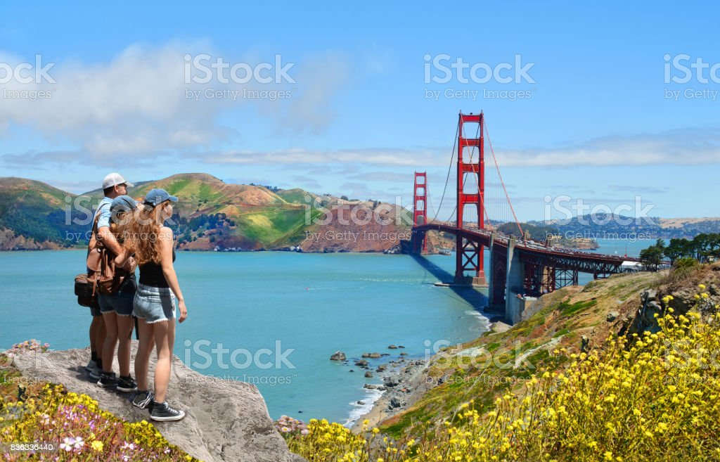 Family looking at beautiful summer mountains landscape, on hiking trip stock photo