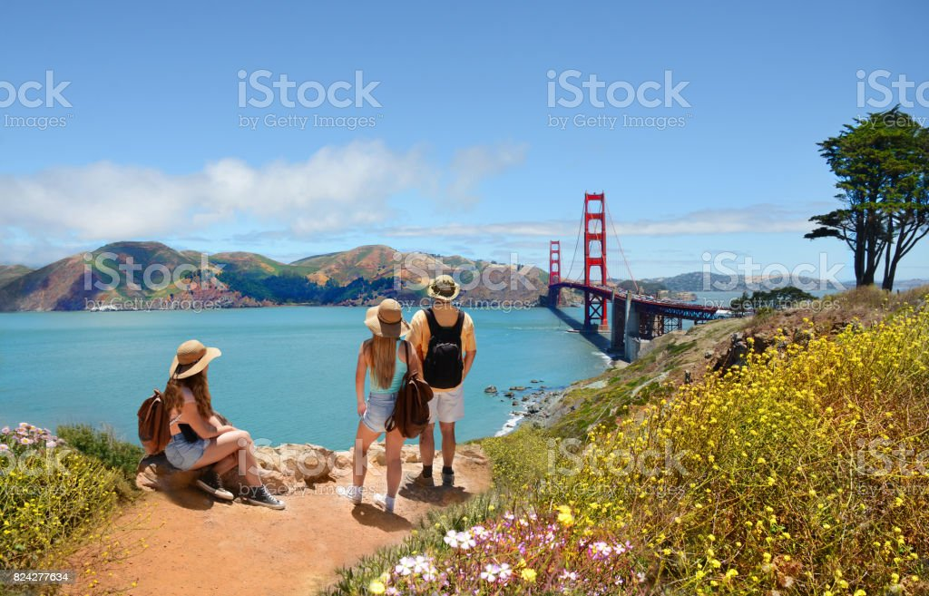 Family looking at beautiful summer mountains landscape. stock photo
