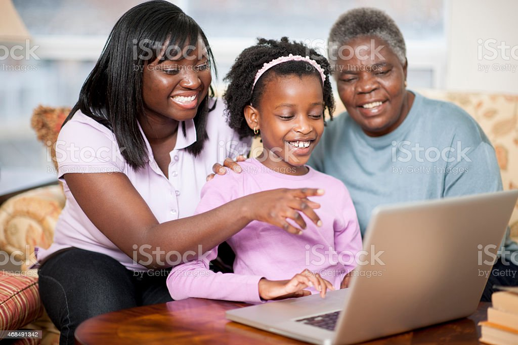 Family Looking at Laptop stock photo