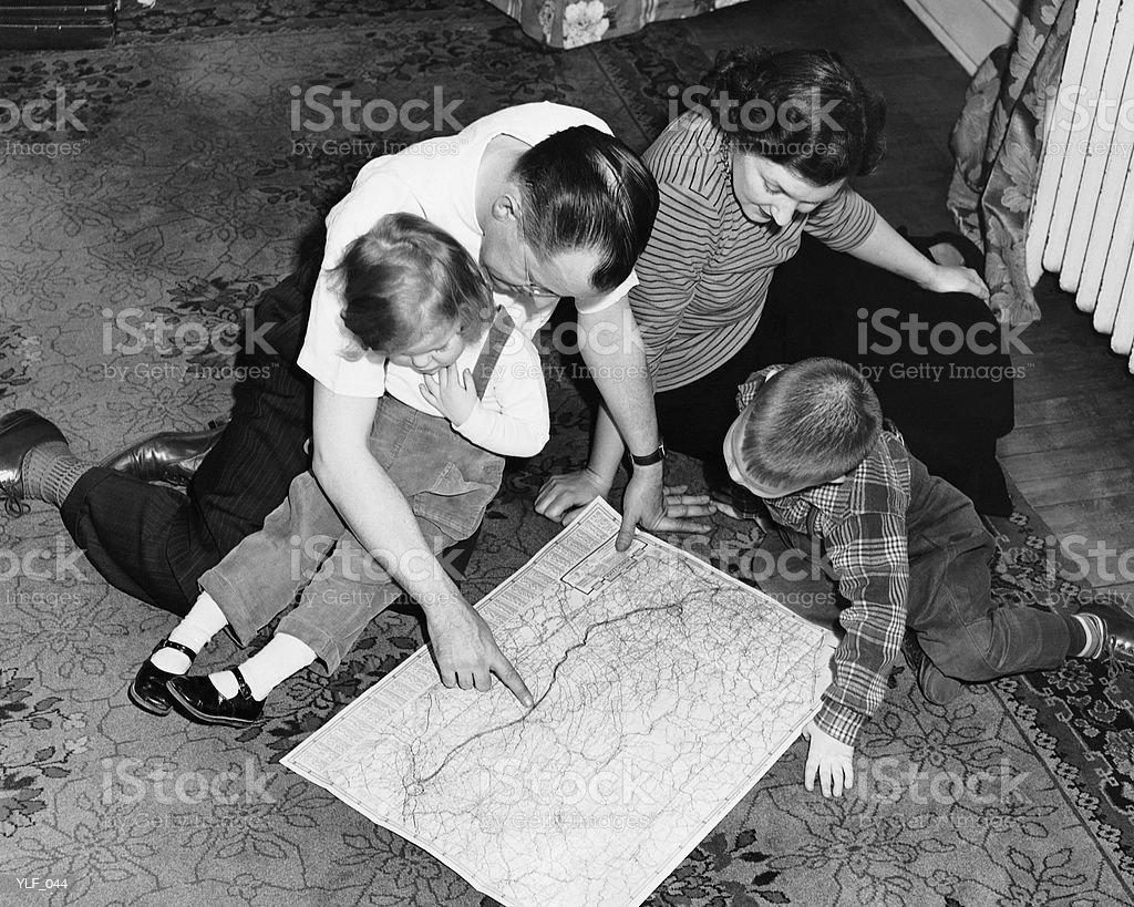 Family looking at roadmap royalty-free stock photo