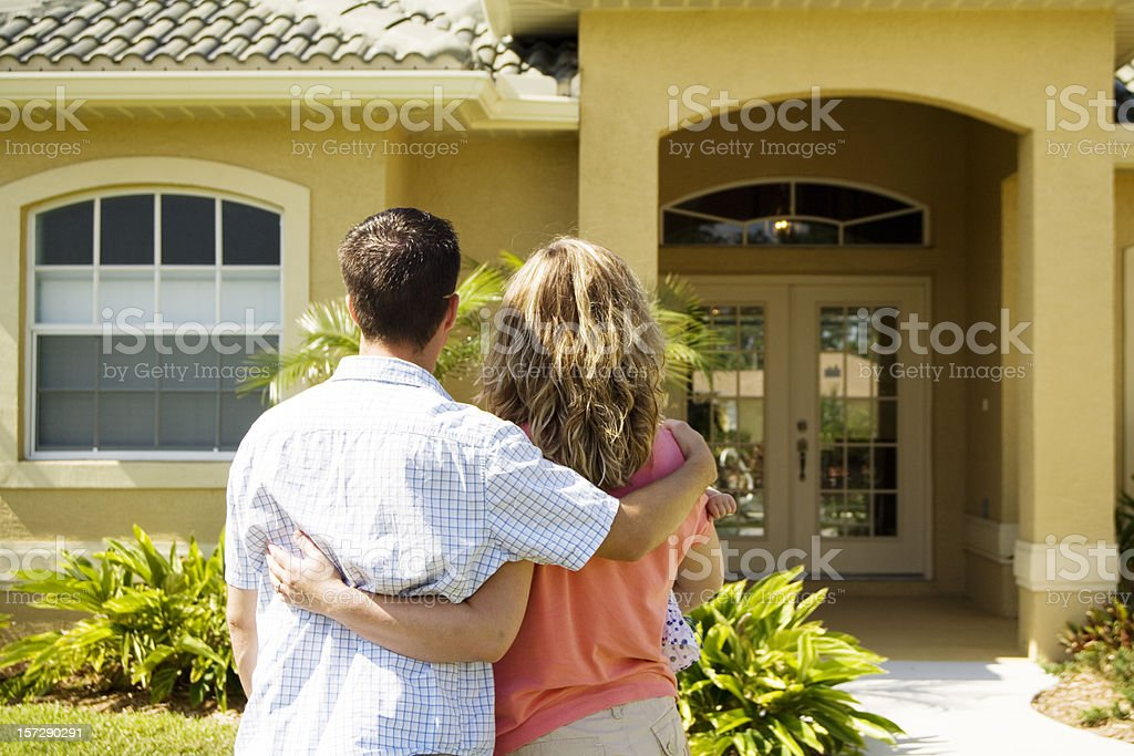 Family looking at the outside of their home stock photo