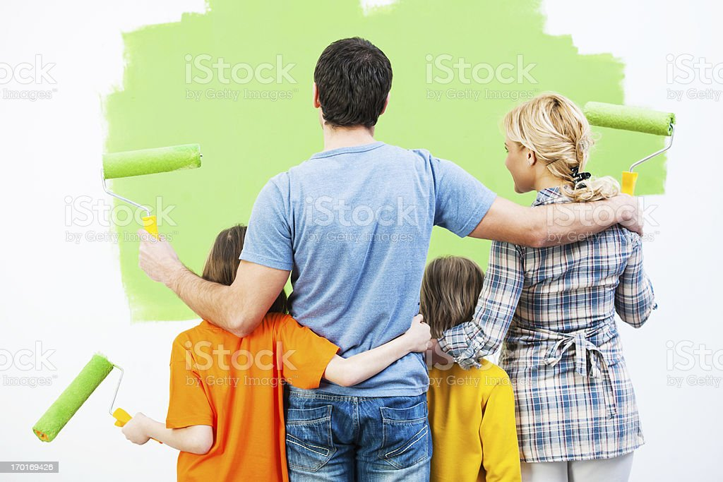 Family looking at the painted wall. royalty-free stock photo