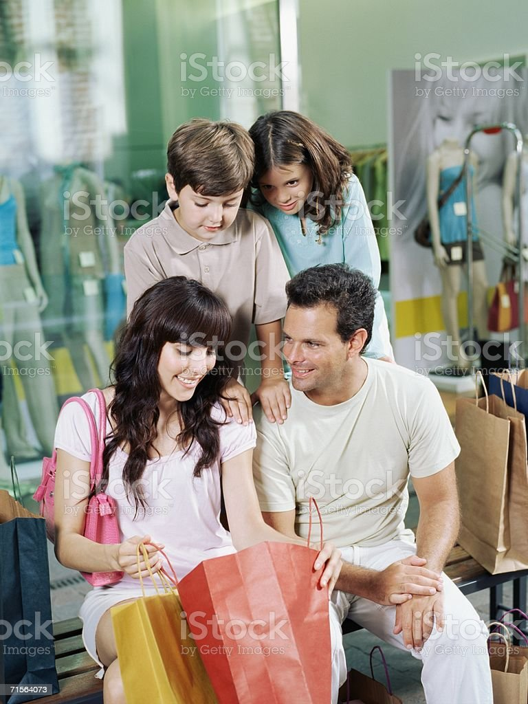 Family looking in shopping bag royalty-free stock photo