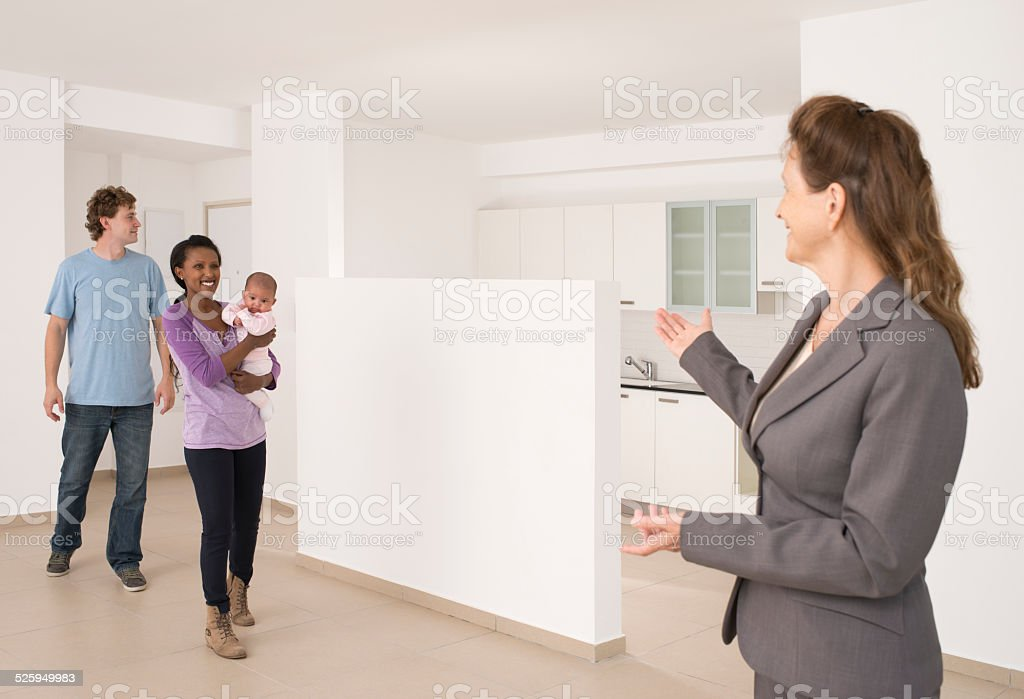Family looking new home. stock photo