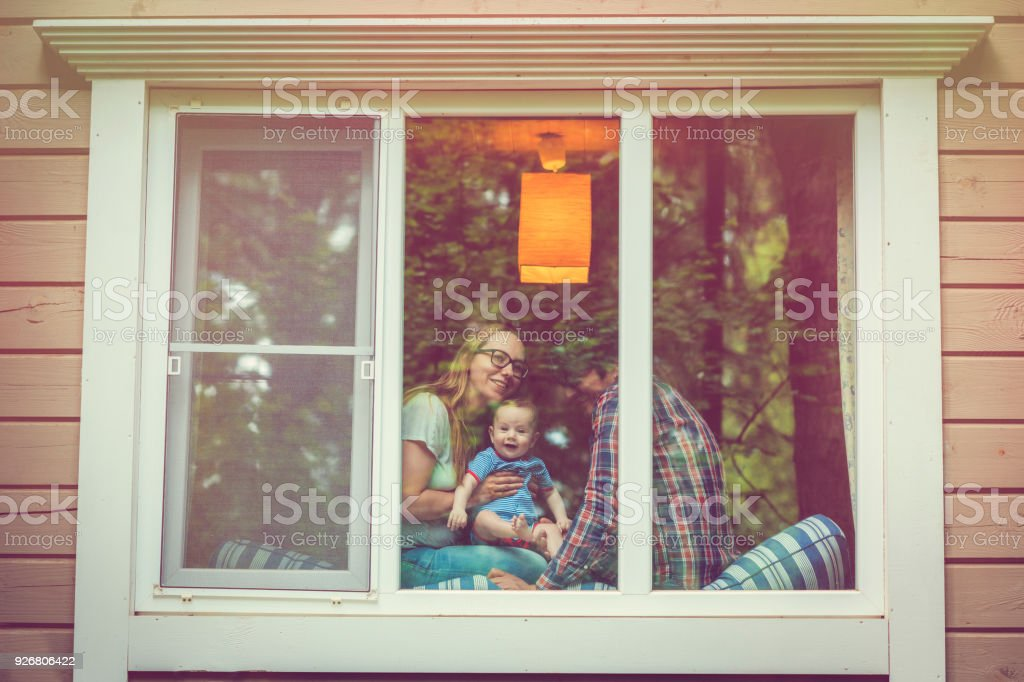 Family looking out of the window stock photo
