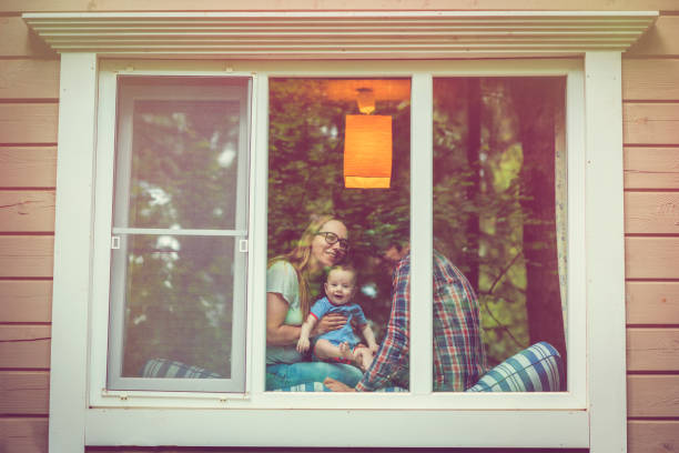 family looking out of the window - safe stock photos and pictures