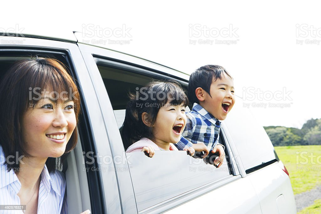 Family looking prairei from car window stock photo