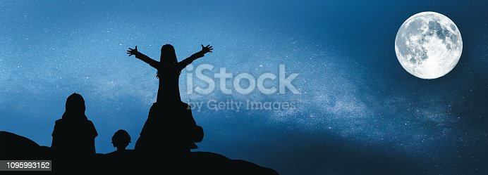 istock Family looking up to the moon. 1095993152