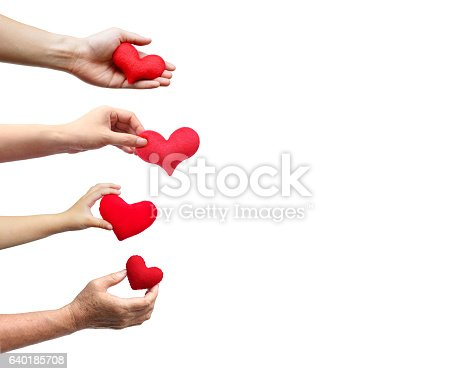 Family love isolated. Family members - father, mother, child, and grandmother holding red hearts on isolated background
