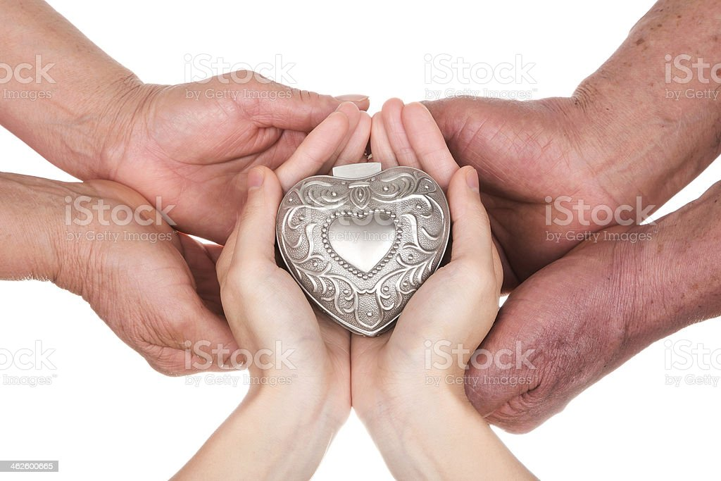 Family Love:senior parents and daughter holding heart royalty-free stock photo