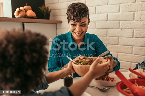 Cute family having lunch together.
