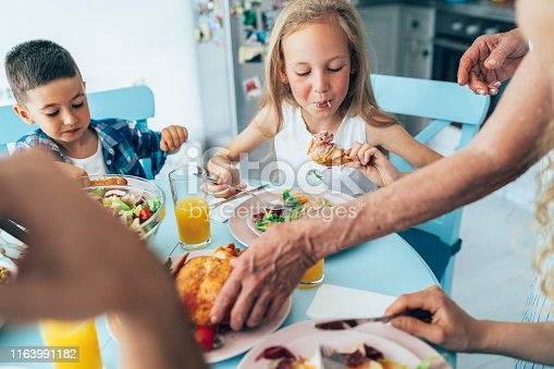 Big Cheerful family in kitchen having lunch