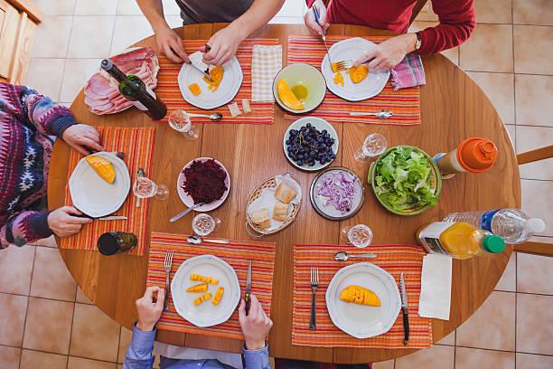 family lunch, top view of the table - spieltag vorspeisen stock-fotos und bilder