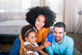 istock Family lying on carpet  take a selfie with smart phone 540611930