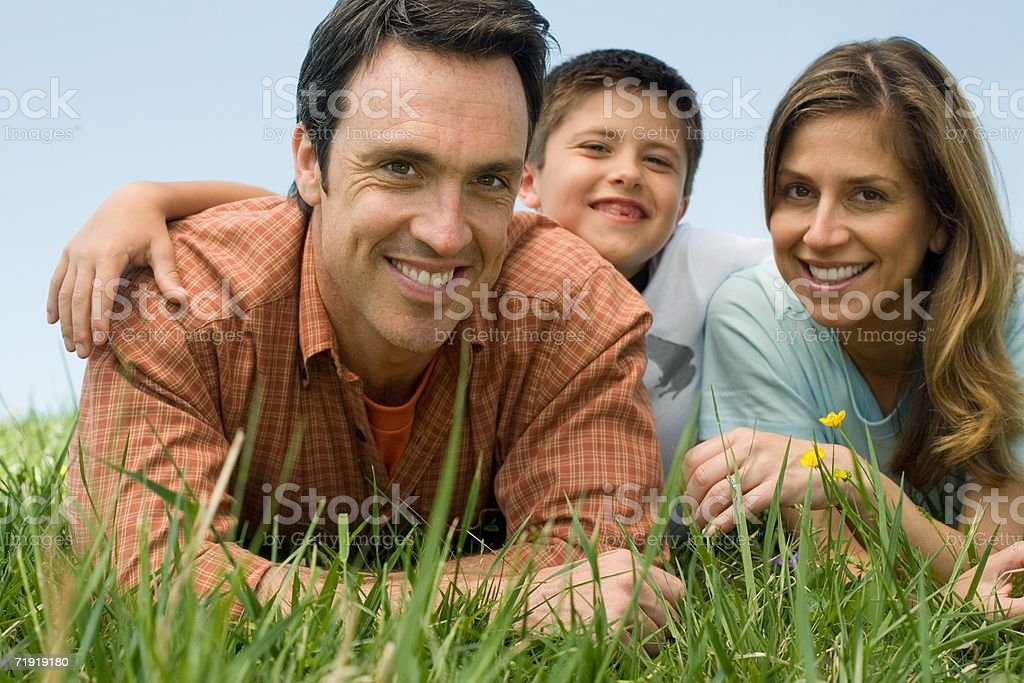 Family lying on meadow royalty-free stock photo