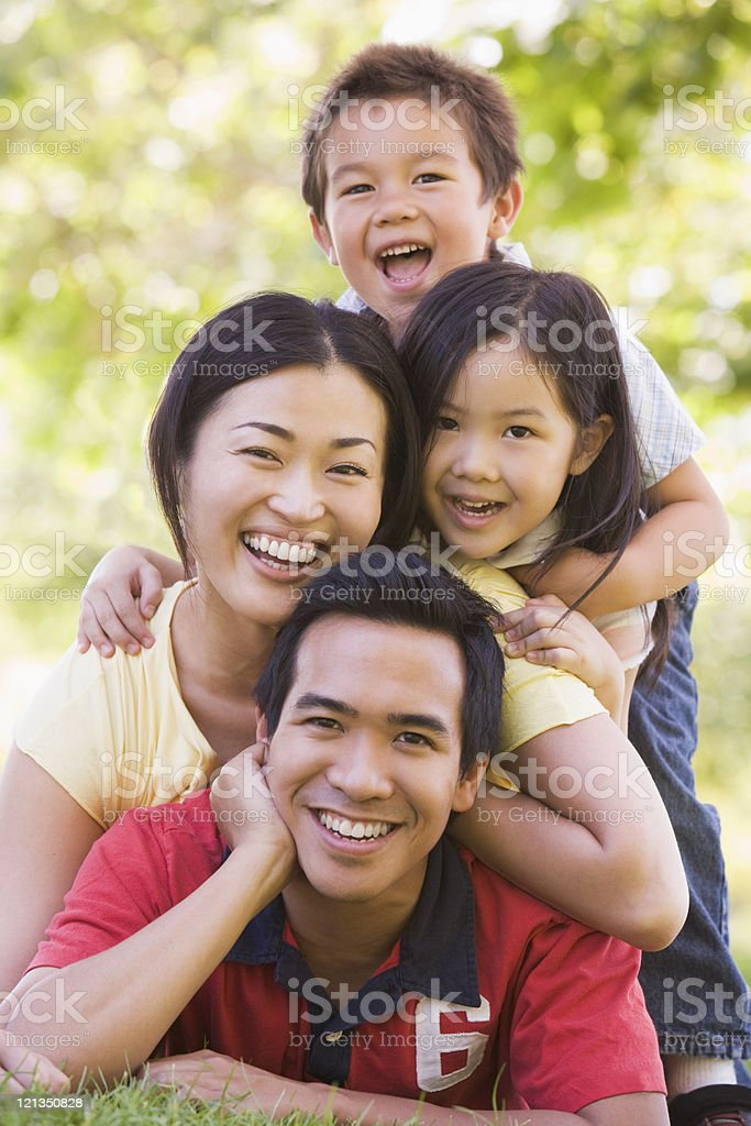 Family lying outdoors smiling stock photo