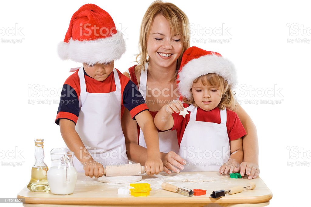 Family making cookies at christmas time royalty-free stock photo