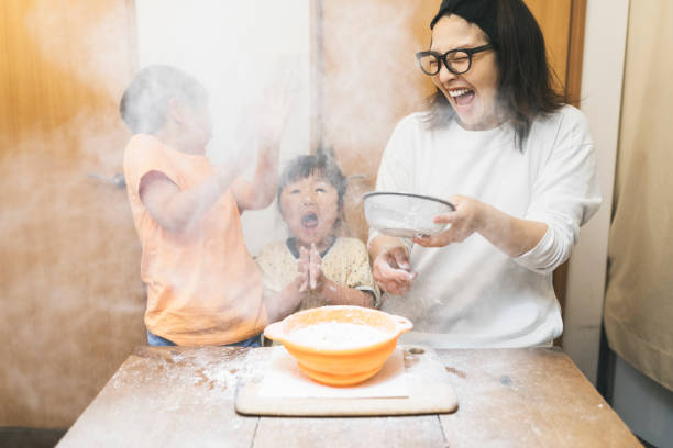 family making cookies at home - fail cooking imagens e fotografias de stock
