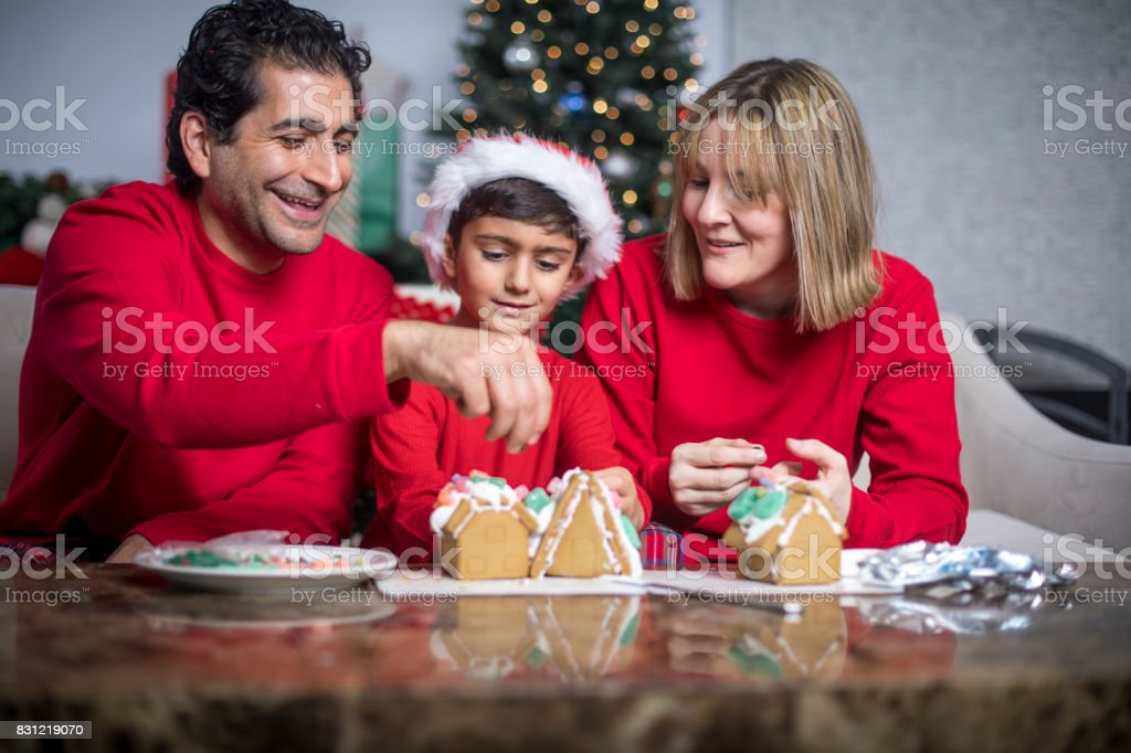 Family Making Gingerbread House stock photo