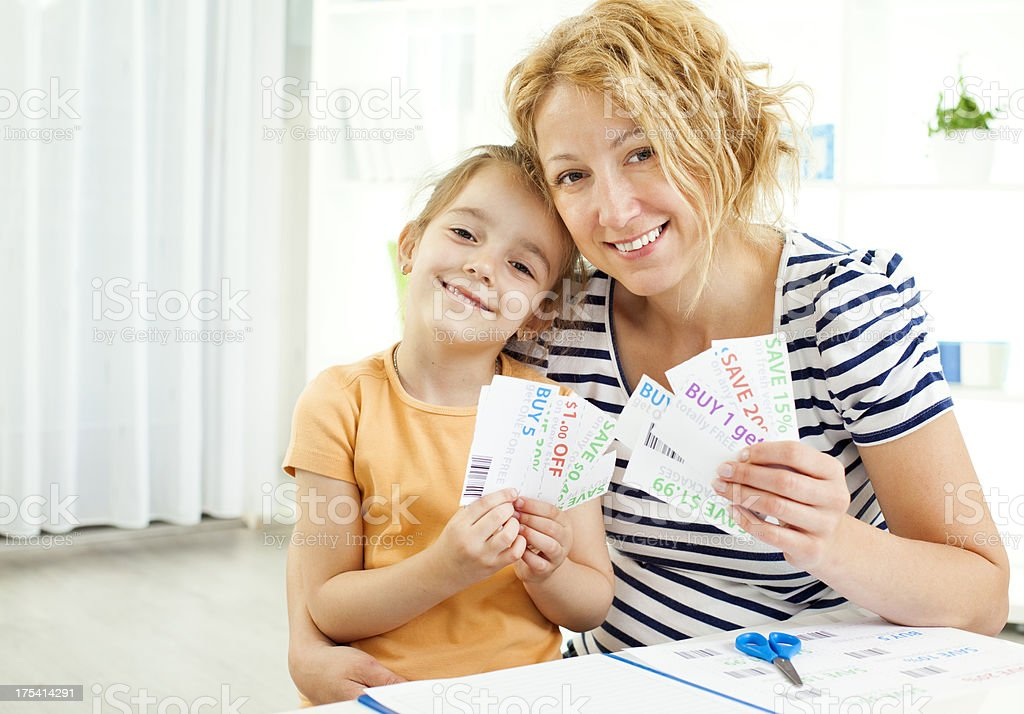 Family Making Shopping list and coupons. royalty-free stock photo