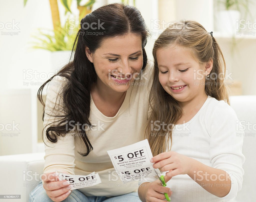 Family Making Shopping list and cutting coupons stock photo
