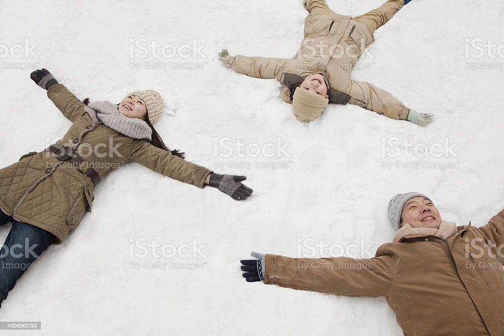 Family making snow angels stock photo