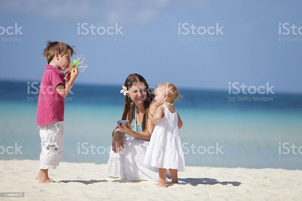 Family making soap bubbles royalty-free stock photo