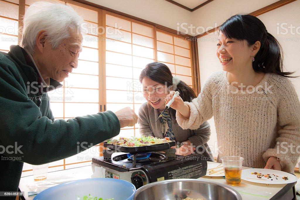 Family making Takoyaki for lunch/dinner stock photo