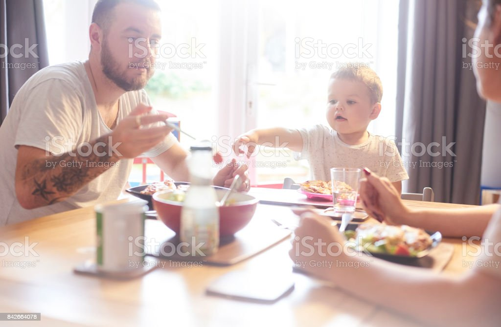 Family meal time at the table stock photo