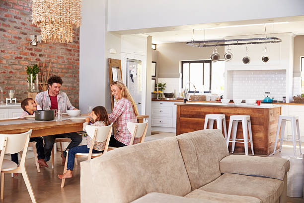 family mealtime at home - family room stock photos and pictures