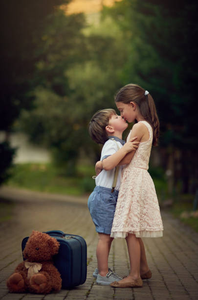 family means love forever - little girls little boys kissing love stock photos and pictures