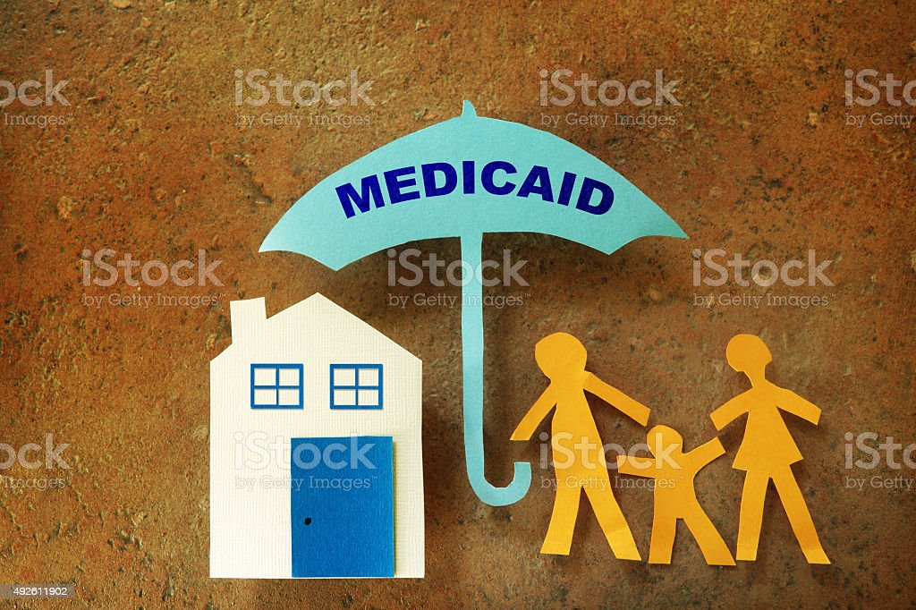 Family Medicaid umbrella stock photo