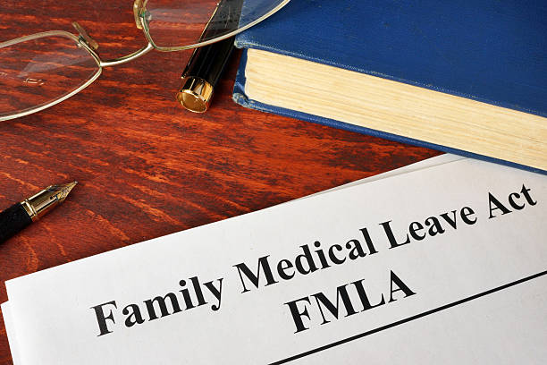 fmla family medical leave act and a book. - paid stock pictures, royalty-free photos & images