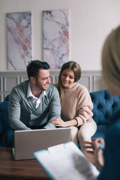 Family meeting real-estate agent for house investment. stock photo