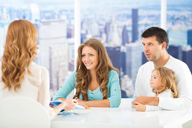 family meeting with financial advisor. - four lawyers stockfoto's en -beelden