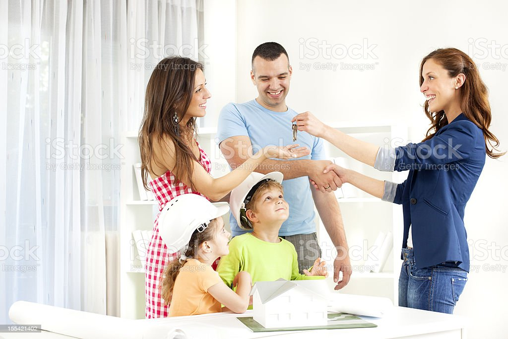 Family Meeting With Real Estate Agent. stock photo