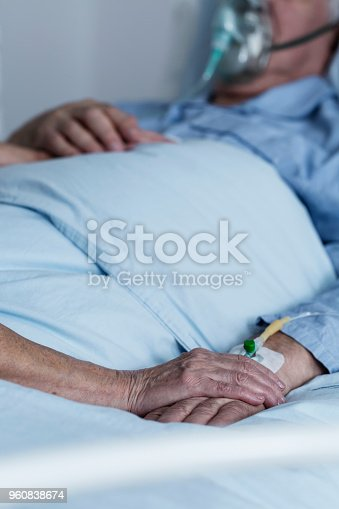 886711404istockphoto Family member comforting dying patient 960838674