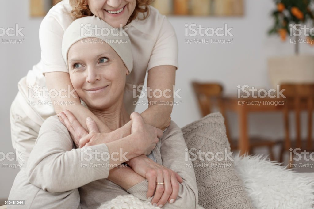 Family member supporting sick woman stock photo