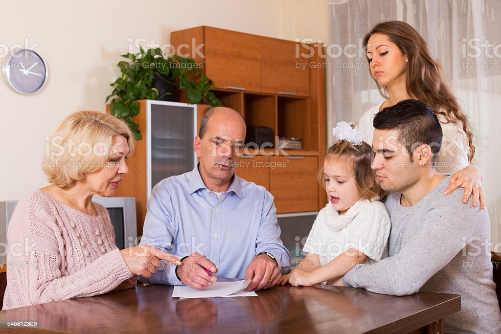 Family members with bills stock photo