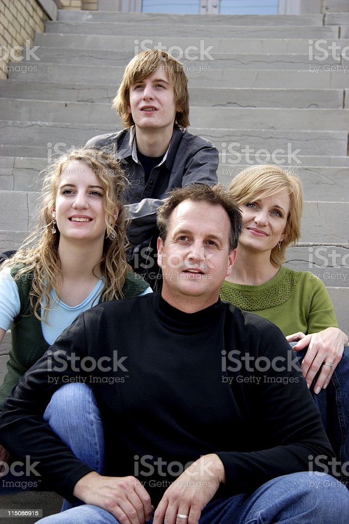 family   - middle aged man woman and teens royalty-free stock photo