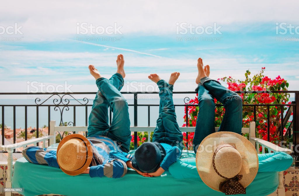 family- mom, dad and son- relax on balcony terrace royalty-free stock photo